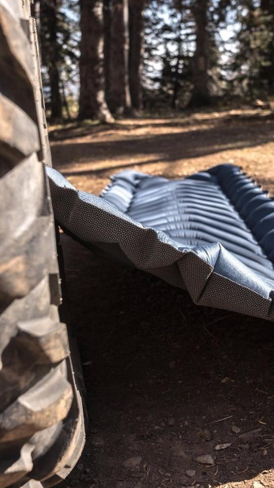 """The Klymit Armored V relies on a """"SuperFabric"""" bottom to hold up to the rough, uneven terrain below the tent floor"""
