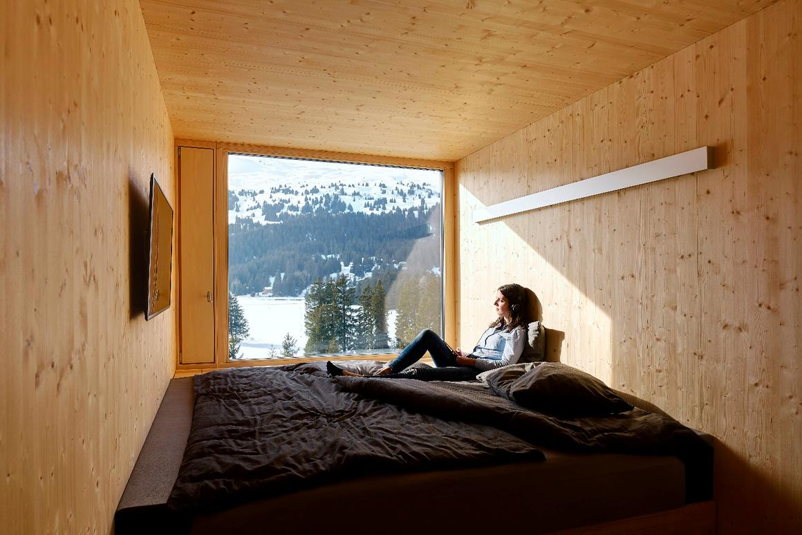 Each of the 96 rooms making up the four floors of theRevierMountain Lodge wascrafted from natural unfinished plywood andfabricated off site