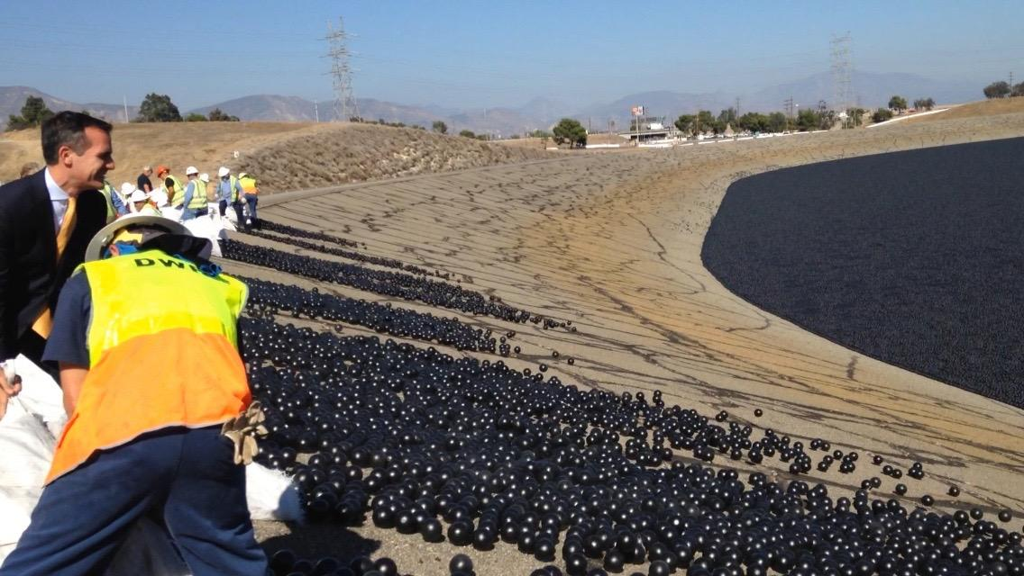 The shade balls getting dispersed into the LA Reservoir