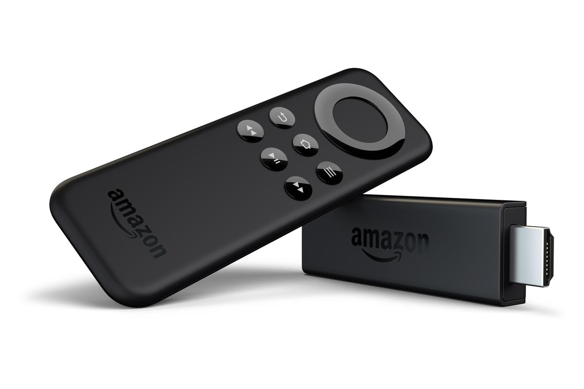 The Fire TV Stick and included remote control