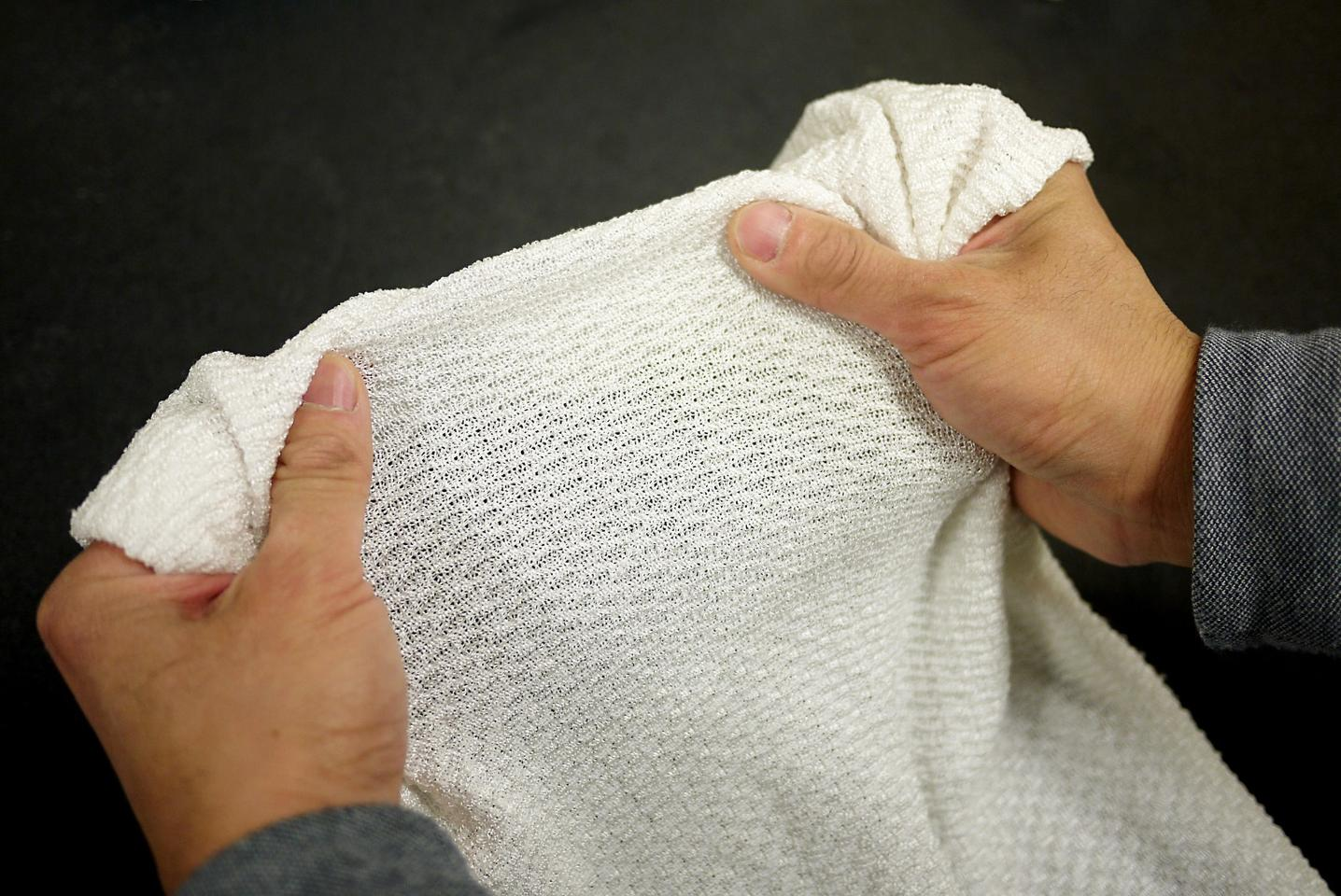 A new fabric reacts by opening its pores and changing the way it electromagnetically responds to infrared