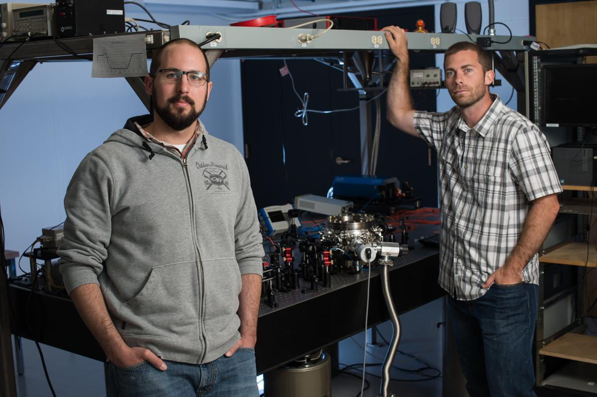 University of Rochester optics professor Nick Vamivakas [R] and physics Ph.D. candidate Levi Neukich perform experiments with optically levitated nanodiamonds (Photo: J. Adam Fenster/University of Rochester)