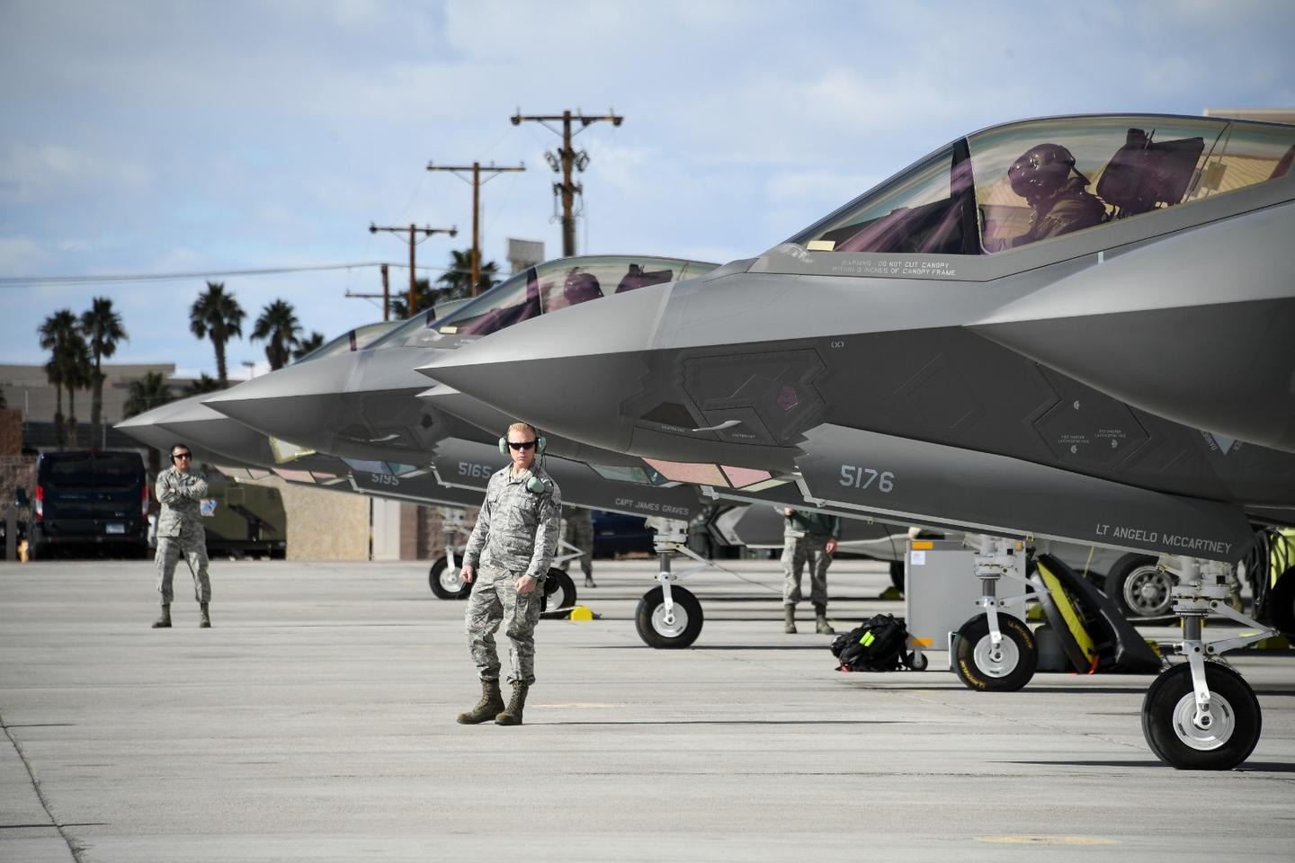 Crew chiefs assigned to the 4th Aircraft Maintenance Unit prepare to launch F-35A Lightning II fighter jets during Red Flag 19-1