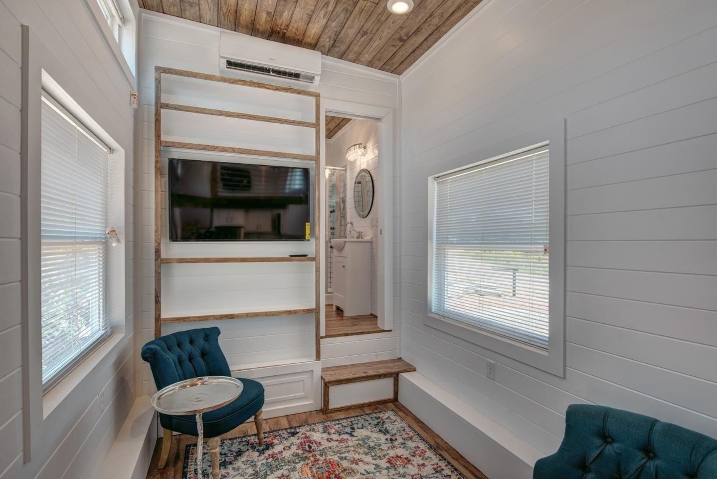 The high ceiling throughout the Journey tiny house gives this luxurious pint-sized dwelling a relatively spacious interior