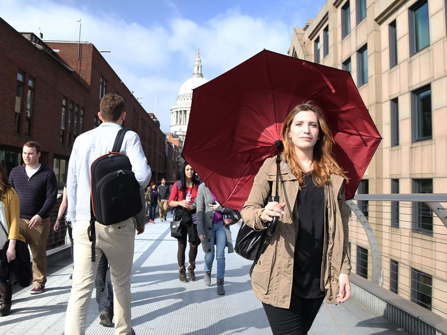 The Kazbrella uses a double-spoke mechanism to fold down in the center rather than at the sides