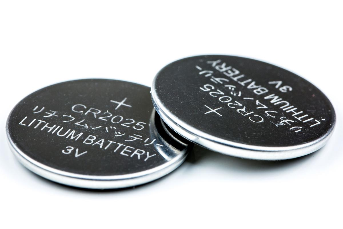 Researchers have developed an organic proton battery (not pictured) that is about the size of a button cell battery