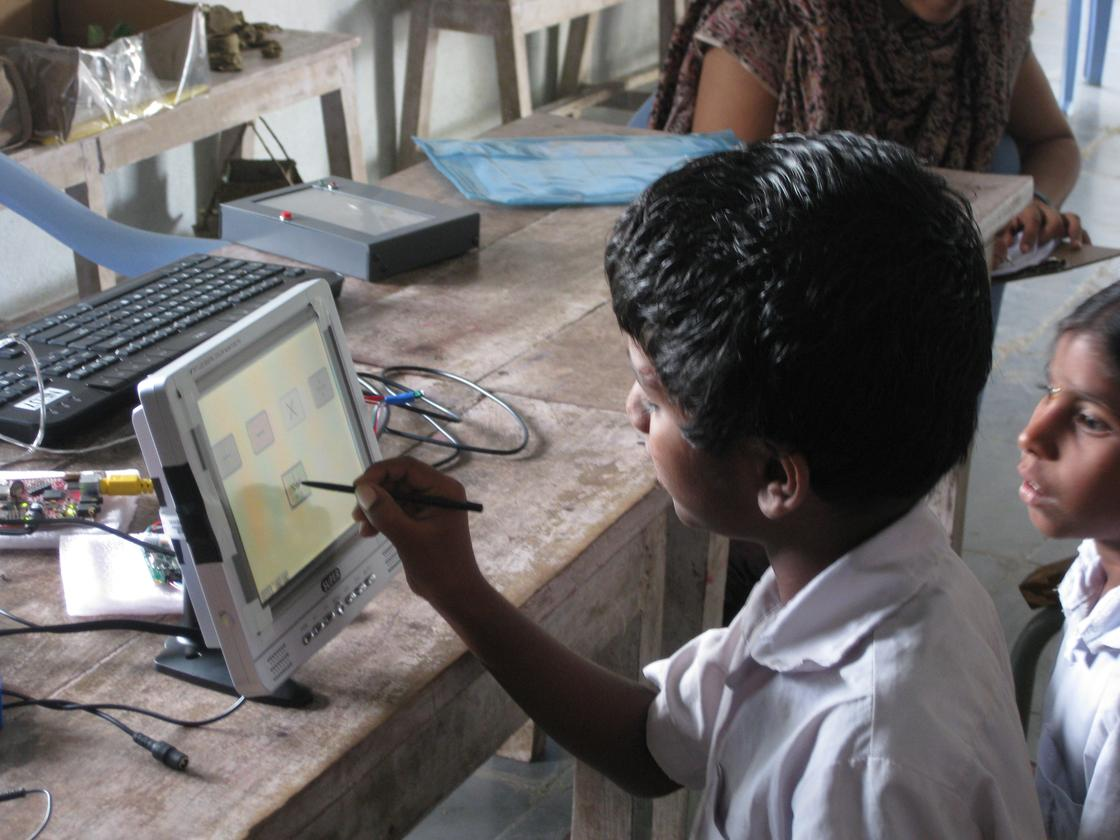 An Indian student trying out a prototype of the I-slate