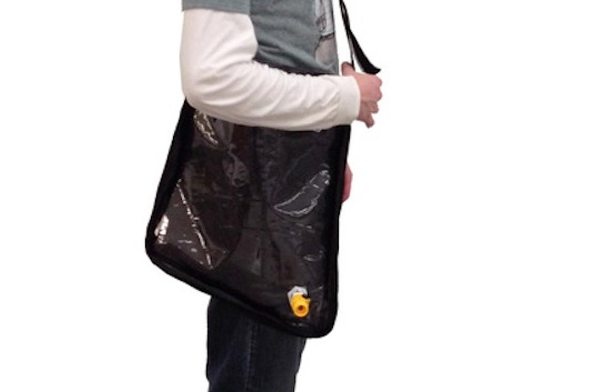 The Solar Bag can be carried like a satchel for easier transport and will begin to purify water as the user walks