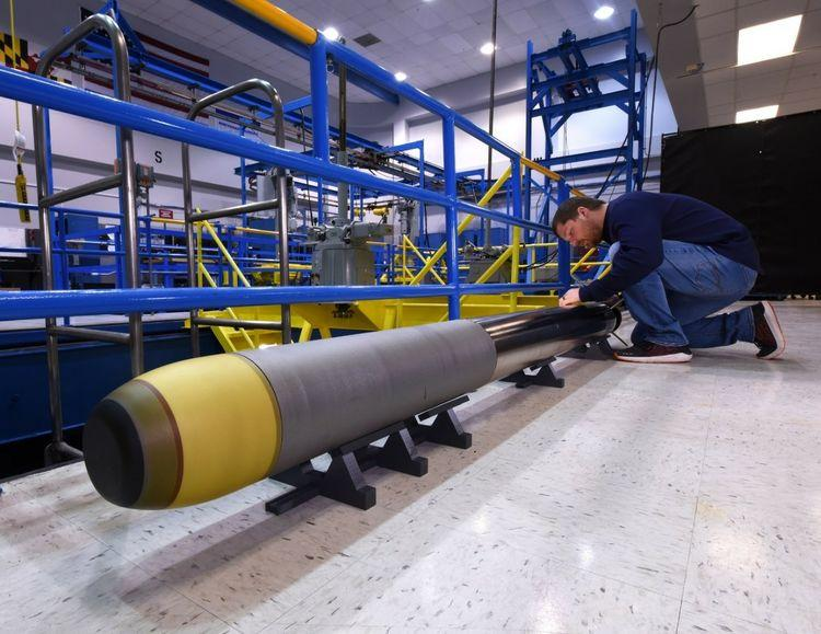 Northrop Grumman's Very Lightweight Torpedo prototype being prepared next to its Acoustic Test Facility tank in Annapolis, Maryland