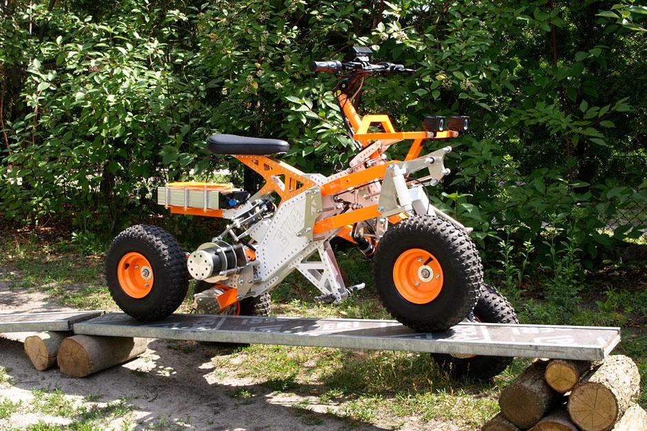 Demonstrating the mechanical titling mechanism on the EV4 off-road electric quad