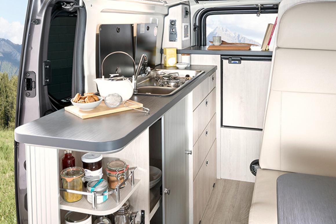 Compact, cozy $53,000 camper van carries four people and a
