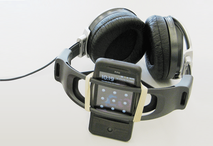 The Oh Music, Where Art Thou? navigation system made from a pair of headphones, an Android smartphone positioned above the user's head and a specially developed app