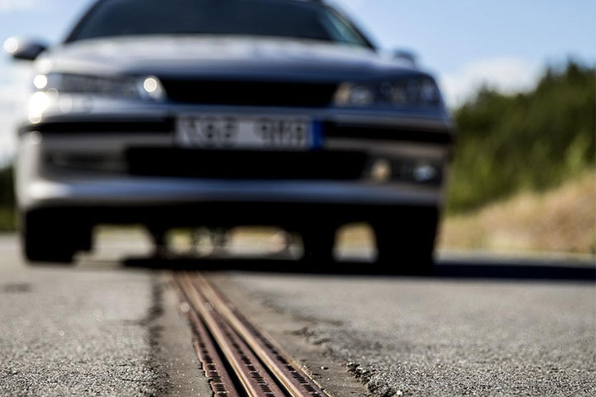 The Swedish project eRoadArlanda powers electric vehicles through a slot car-like track embedded in the road