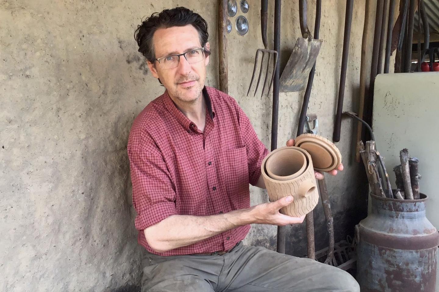 Prof. David Watson with one of the tree-hollow nesting boxes