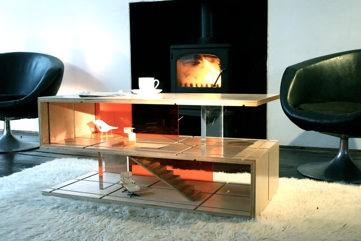 Sliding panels made from wood and perspex are slotted into grooves in the coffee table to make different room layouts