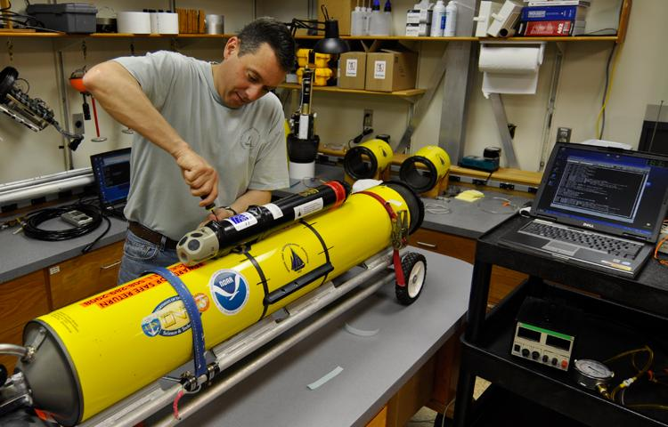 Dave Fratantoni, a scientist in the WHOI Physical Oceanography Department, does some work on the whale-detecting glider (Photo: Nick Woods, Woods Hole Oceanographic Institution)
