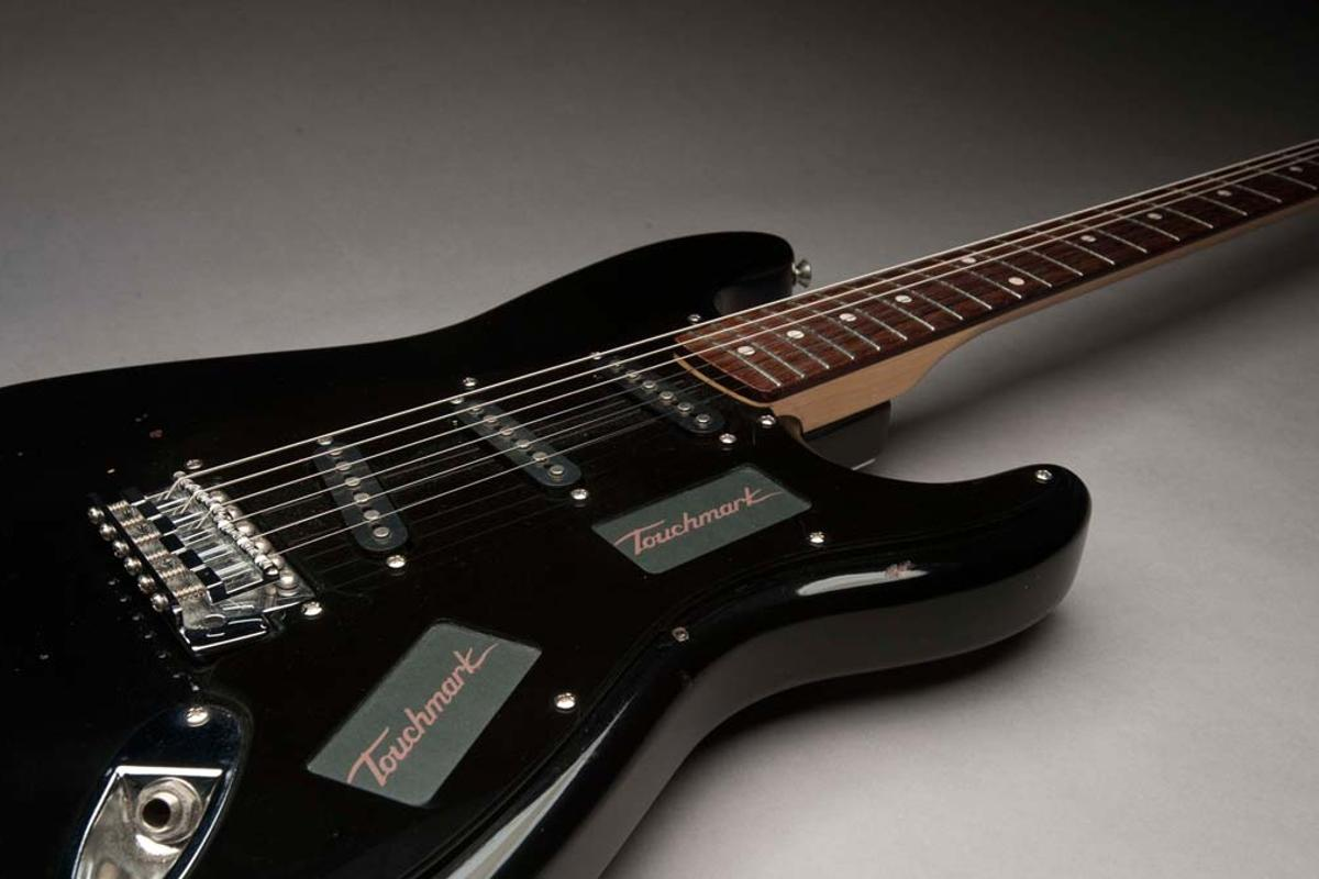 The Touchmark Interface System replaces the volume/tone knobs and pickup selector switch on an electric guitar with touch control panels
