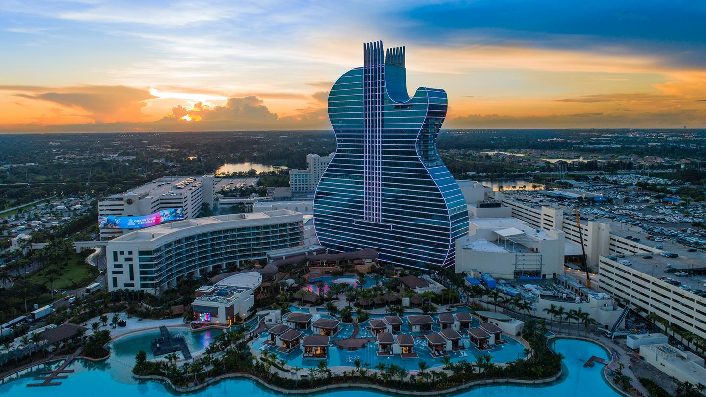 At the Seminole Hard Rock Hotel and Casino, the Guitar Hotel overlooks a 13.5-acre pool and lagoon area with cabana huts dotted over the top