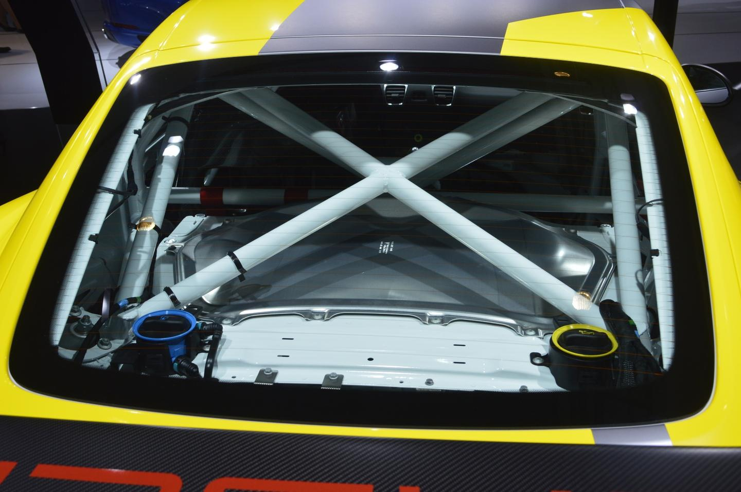 A welded-in safety cage, racing bucket for the driver, and a six-point harness are now standard equipment here