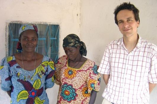 Researcher Thomas Fritz with two of the Mafa women who participated in his music study to demonstrate music conveys emotion across cultures