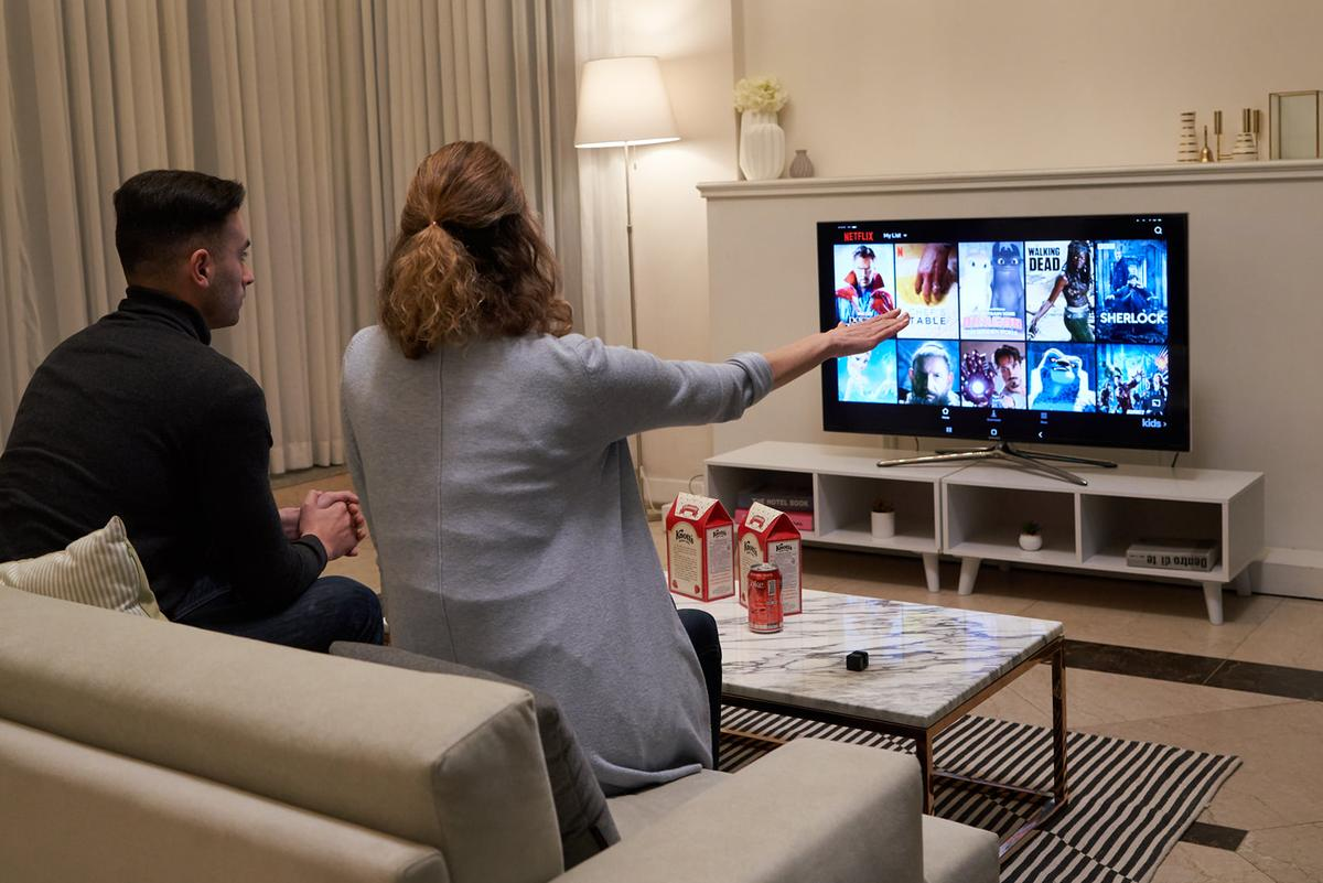 Glamos is a small device that projects a virtual touchscreen in the air, allowing regular TVs to become gesture-controlled