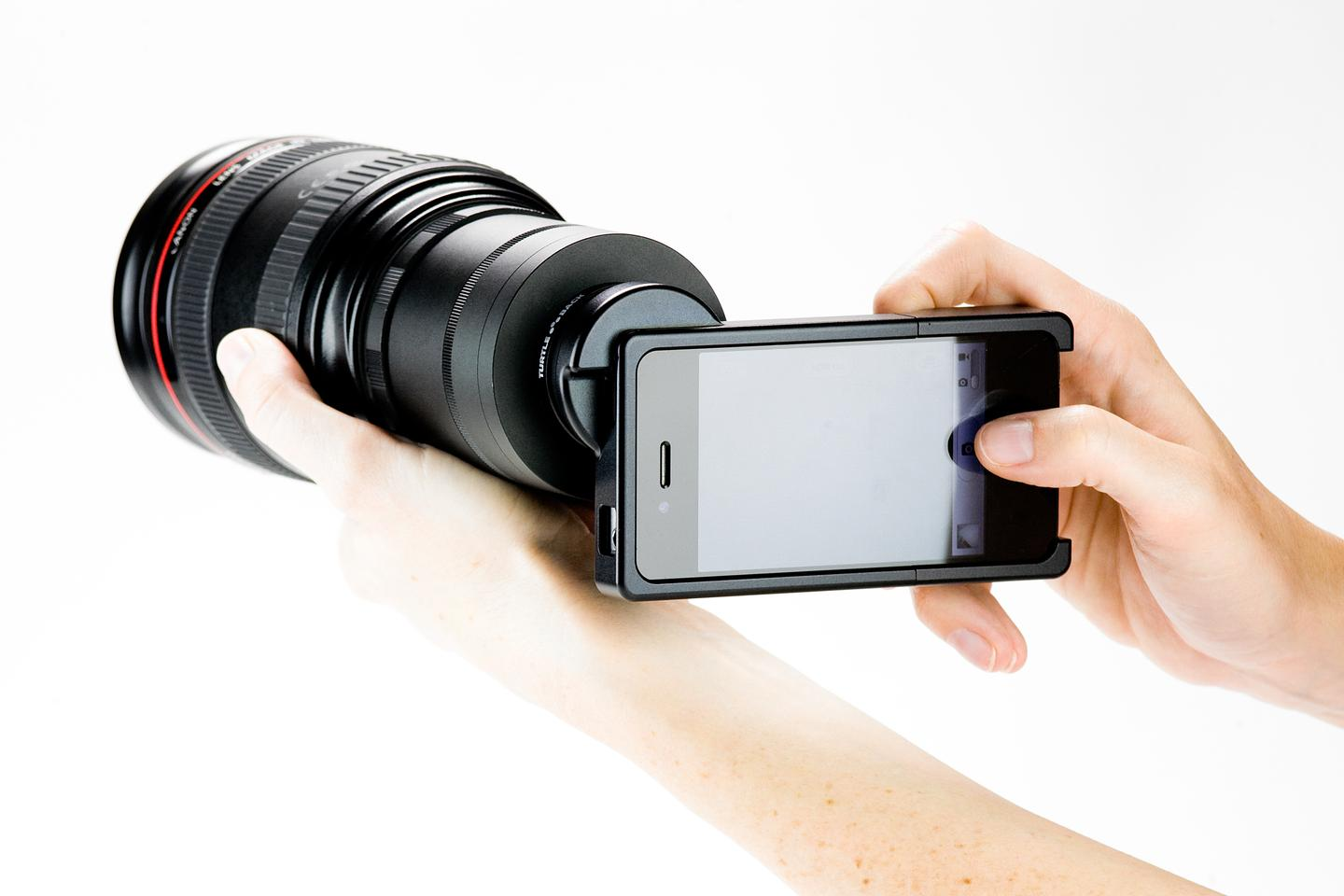 The iPhone SLR Mount comes in either a Nikon F-mount or Canon EF-mount version, and allows iPhoneographers to utilize an SLR lens with the iPhone's camera (Photo: Photojojo)