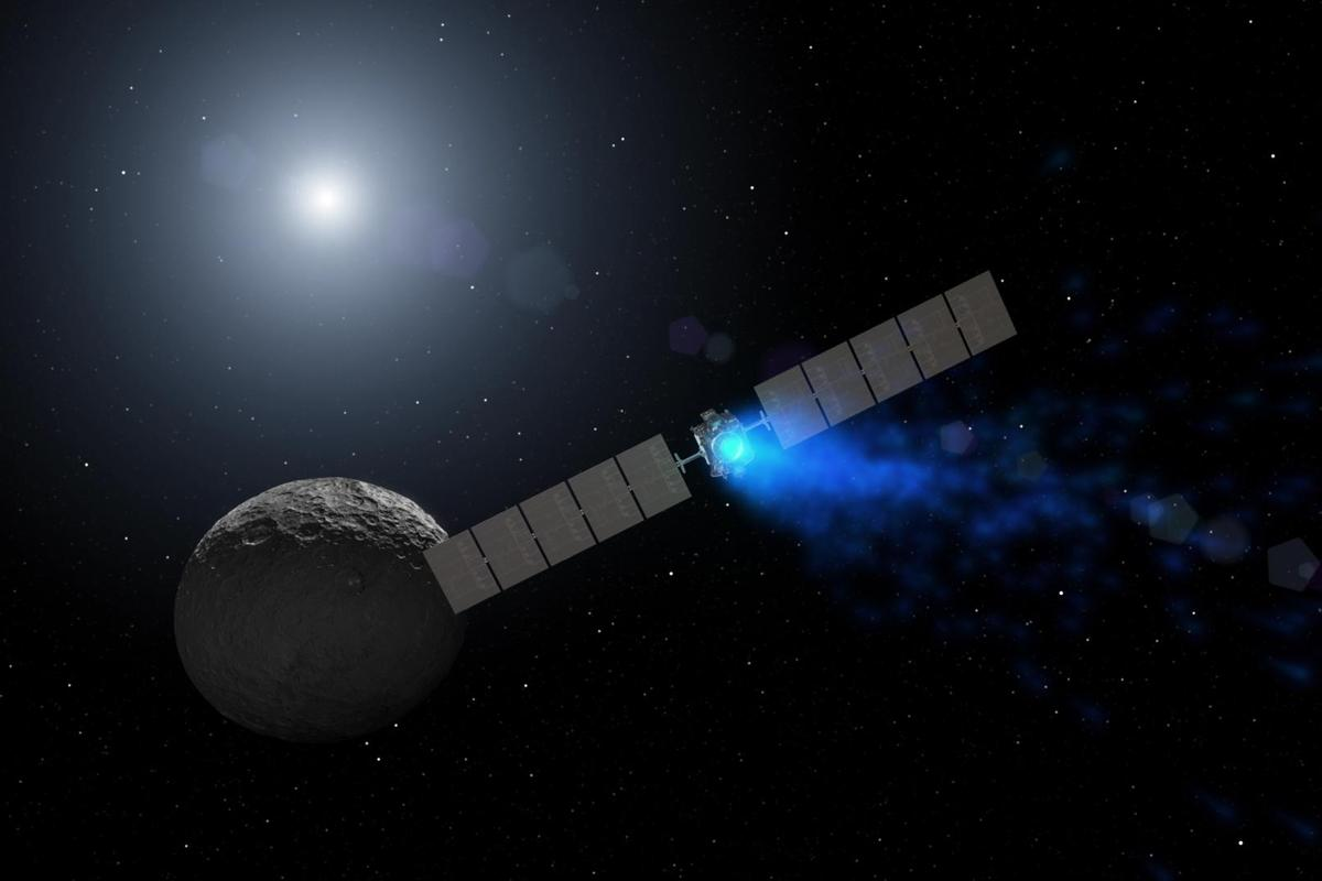 Artist's concept showing Dawn arriving at the dwarf planet Ceres