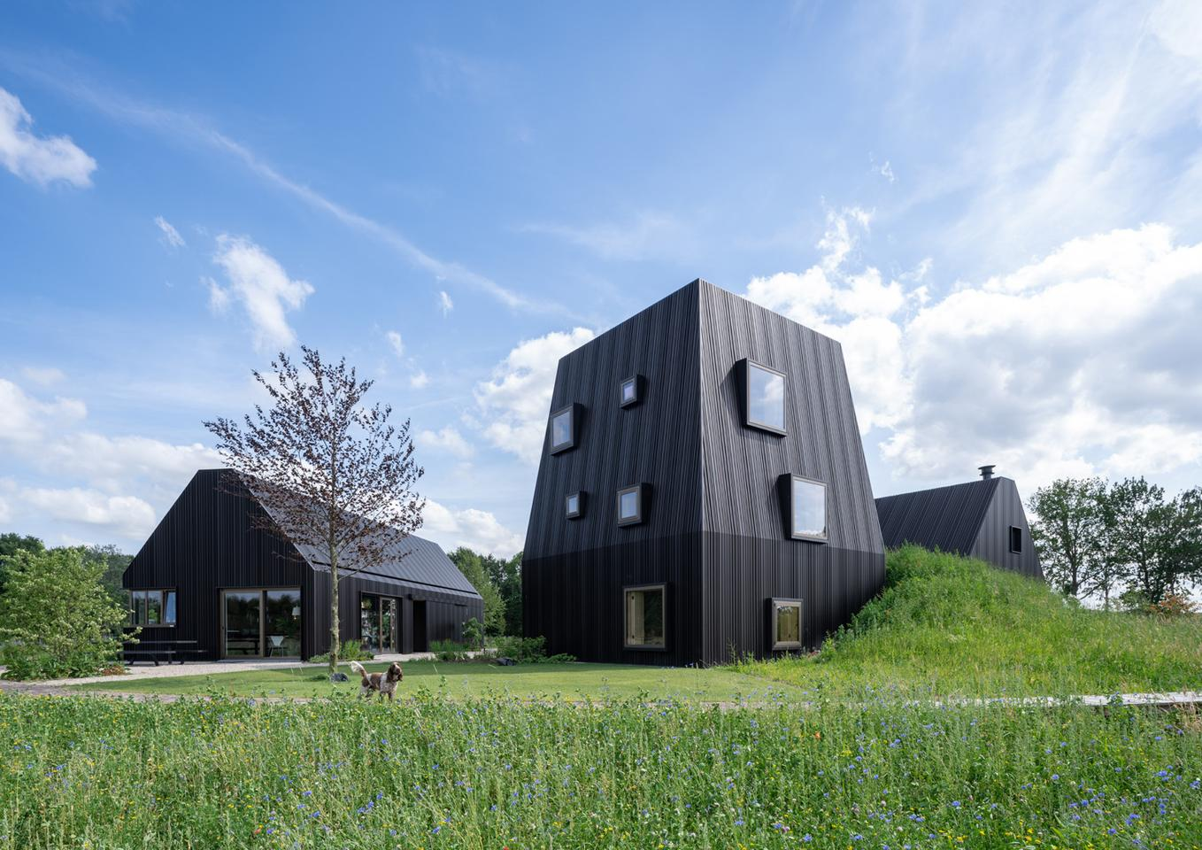 International architectural firm Mecanoo has recently finished a three-part villa in the Netherlands that reinvents the traditional Dutch barn-house