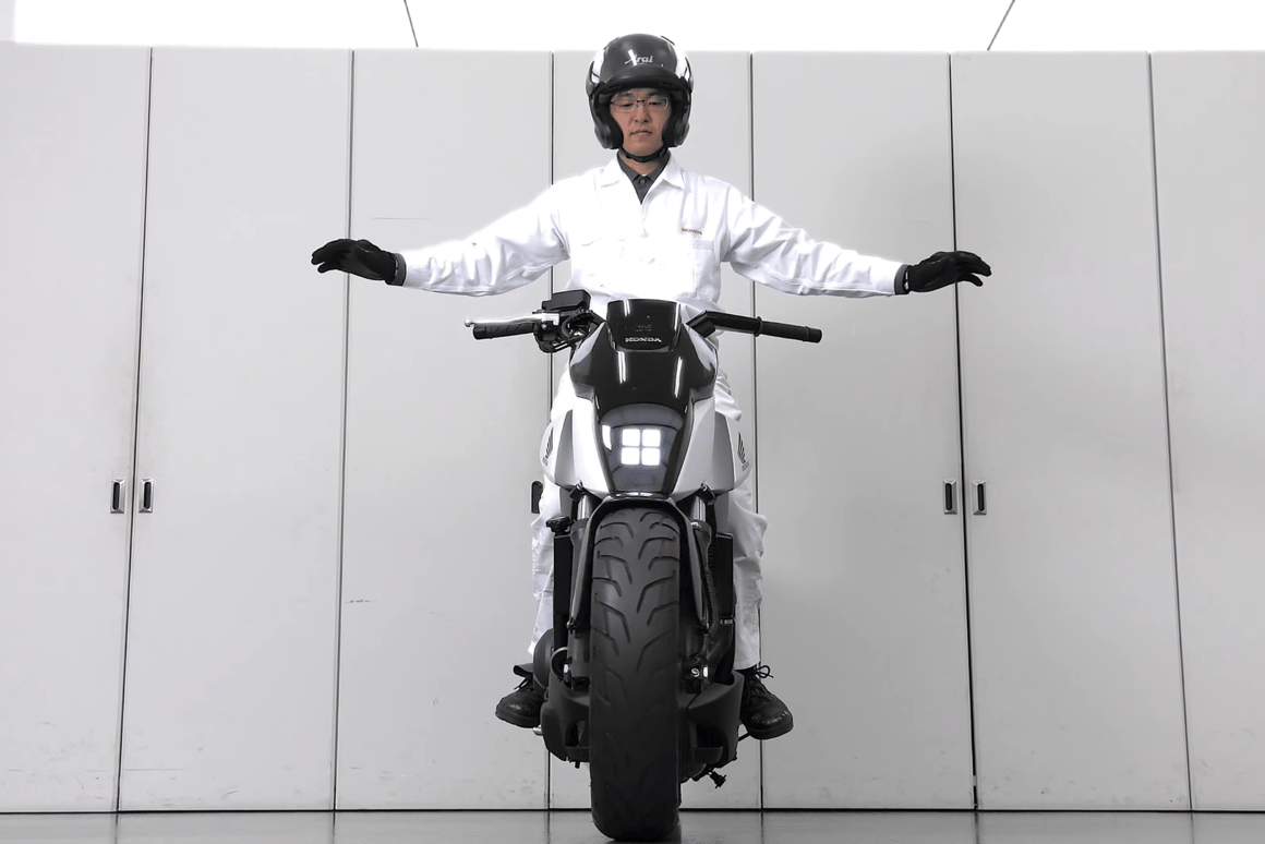 Honda's self-balancing motorcycle: I love to believe Honda R&D guys dress like this all day