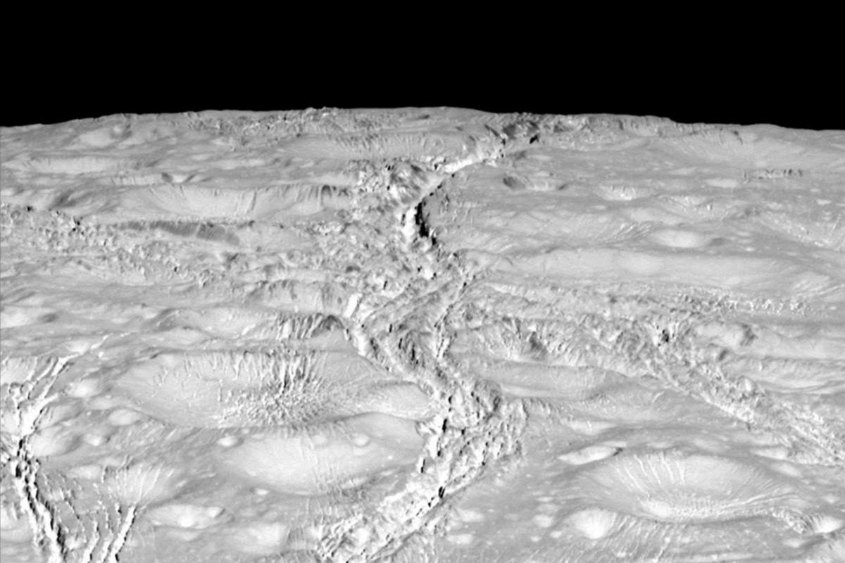 The north polar region is scarred by countless cracks and craters