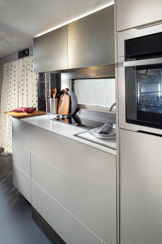 Out of the three floor plans, the 754 DP is the most distinct, offering a central kitchen, connected dry bathroom and front lounge