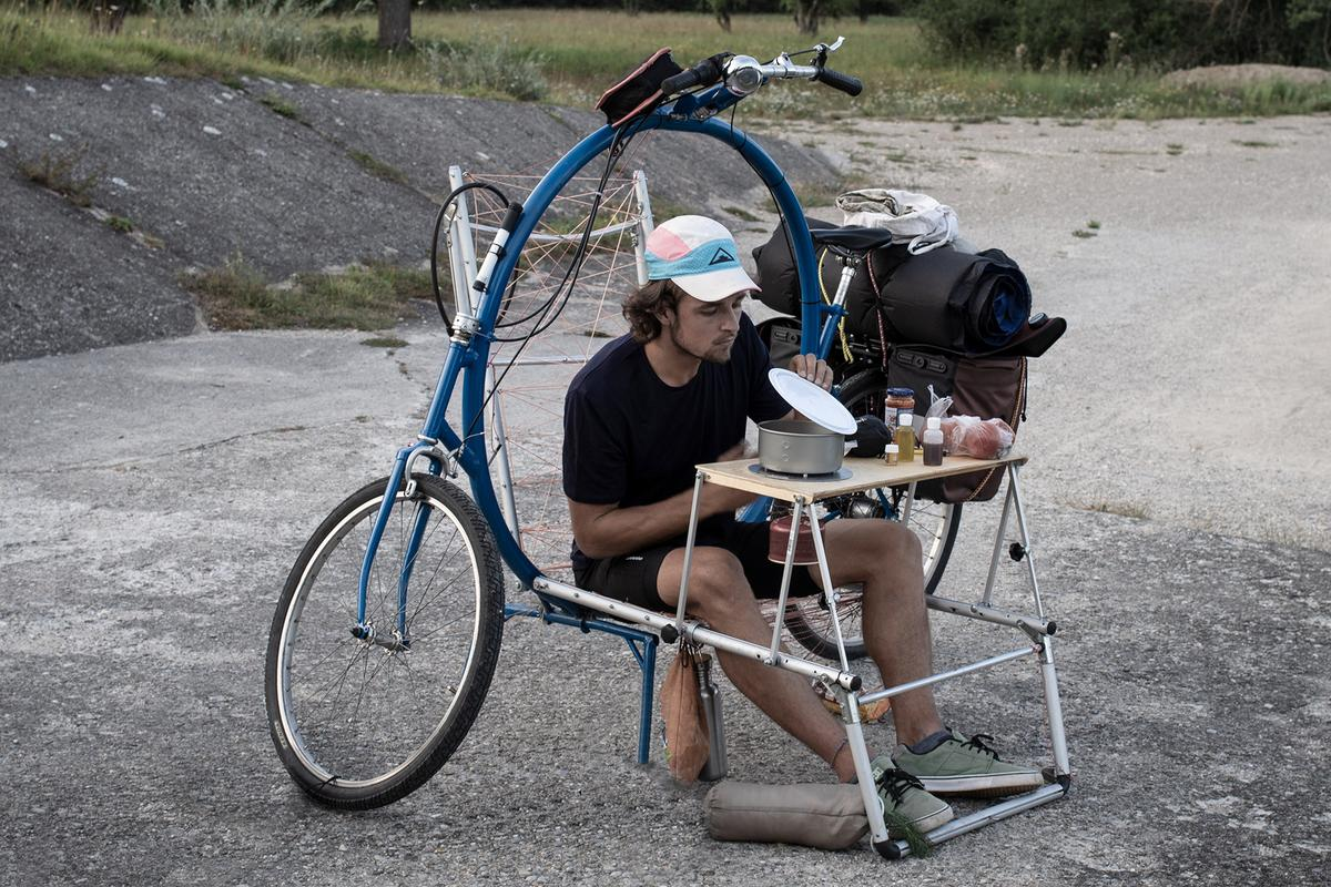 Inventor Bernhard Sobotta stops to chow down during a Cercle bike ride – the chair/table module folds back flat to become a cot