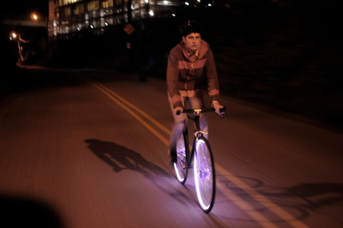 Two groups of entrepreneurs are currently developing separate products (one of which is the Aura system, above), both of which are intended to let bicycle wheels serve as running lights