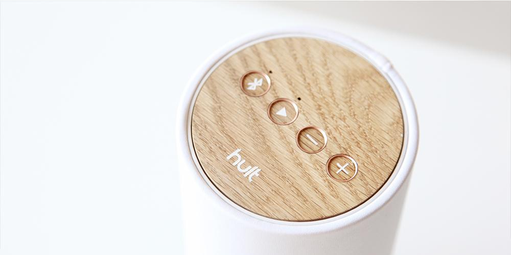 American white oak tops the speaker, with indented touch-enabled control buttons and an LED status indicator
