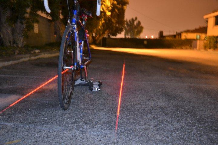 Xfire's Bike Lane Safety Light uses lasers to project a bicycle lane onto the road around around a cyclist
