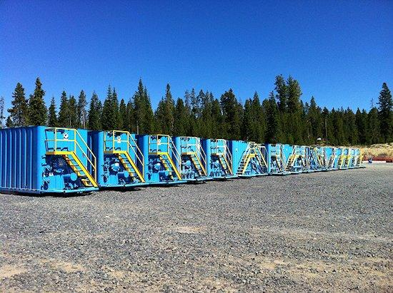 These 17 blue tanks hold over 300,000 gallons of water to supply the stimulation pumps