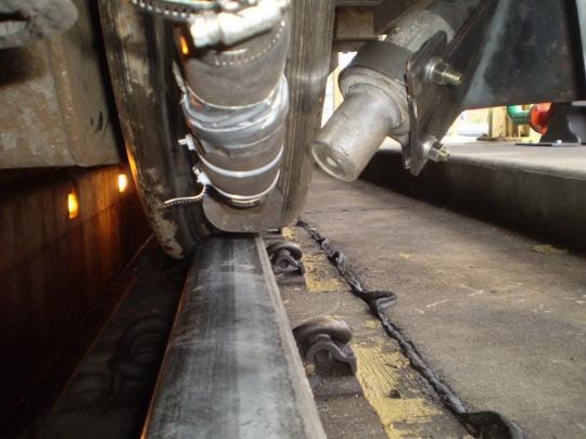 One of the Advanced Rail Cleaner's track-clearing nozzles points at the rail (Photo: GE Transportation)