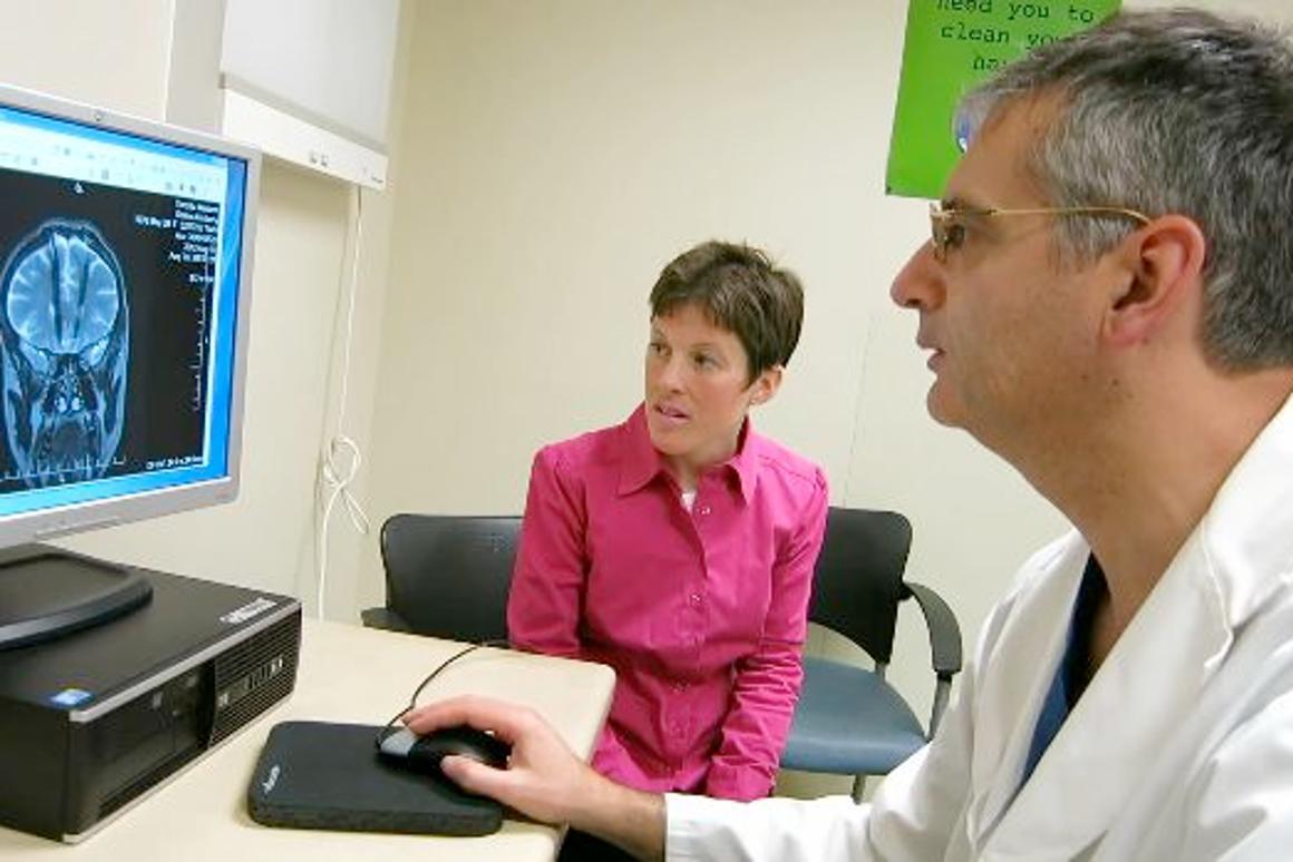 Study participant Kim Rollins and Krembil Neuroscience Centre neurosurgeon Dr. Andres Lozano