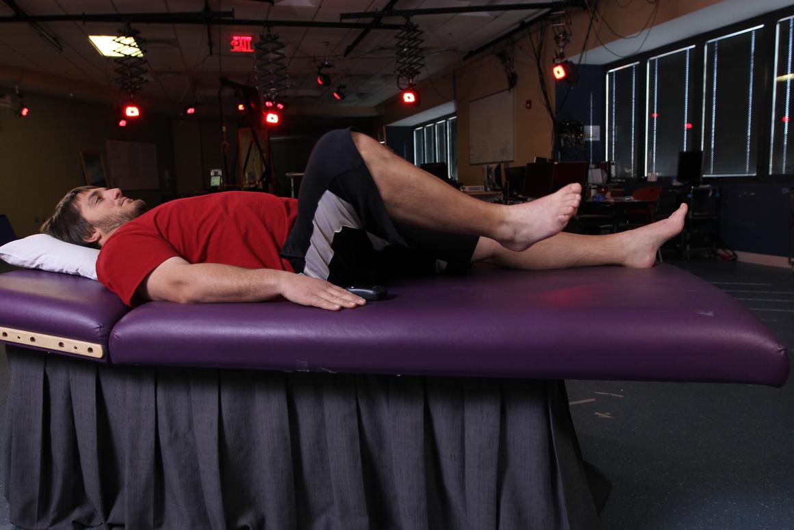 Kent Stephenson bends his leg, thanks to an implanted epidural stimulator