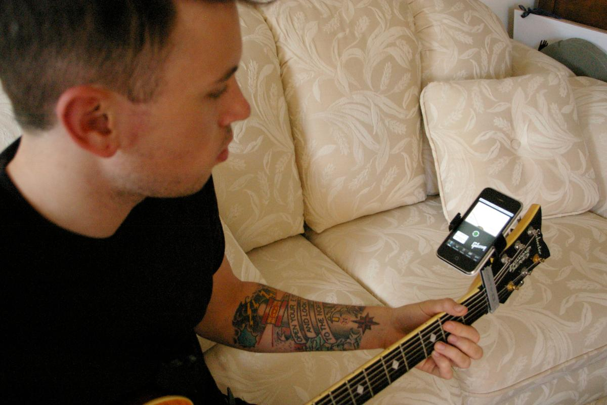 Ready to rock ... the Castiv Guitar Sidekick holds the iPhone while tuning the guitar using the Gibson app