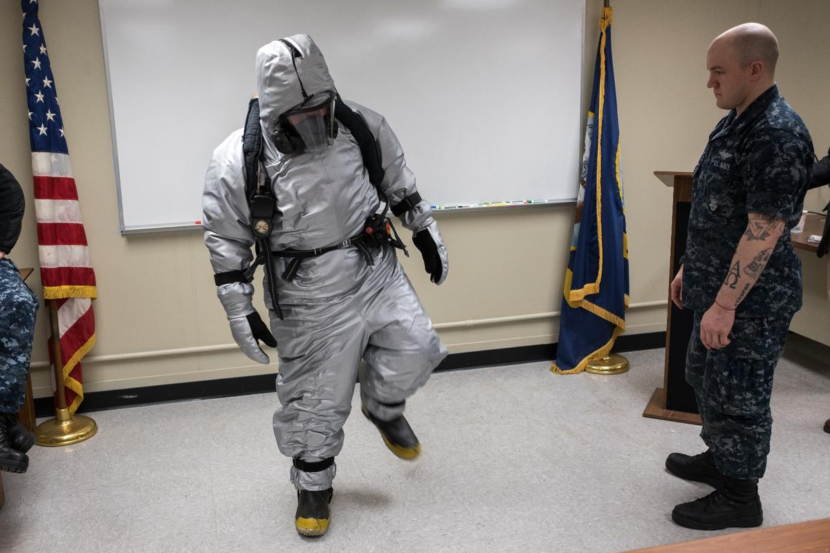 Machinist's Mate nuclear 2nd Class Cameron Sebastian tests a prototype submarine steam suit ensemble