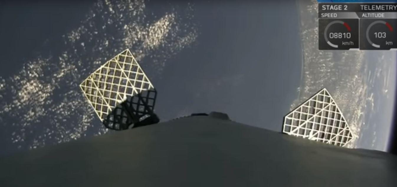 View from the Falcon 9 in orbit showing the steering vanes deployed for reentry
