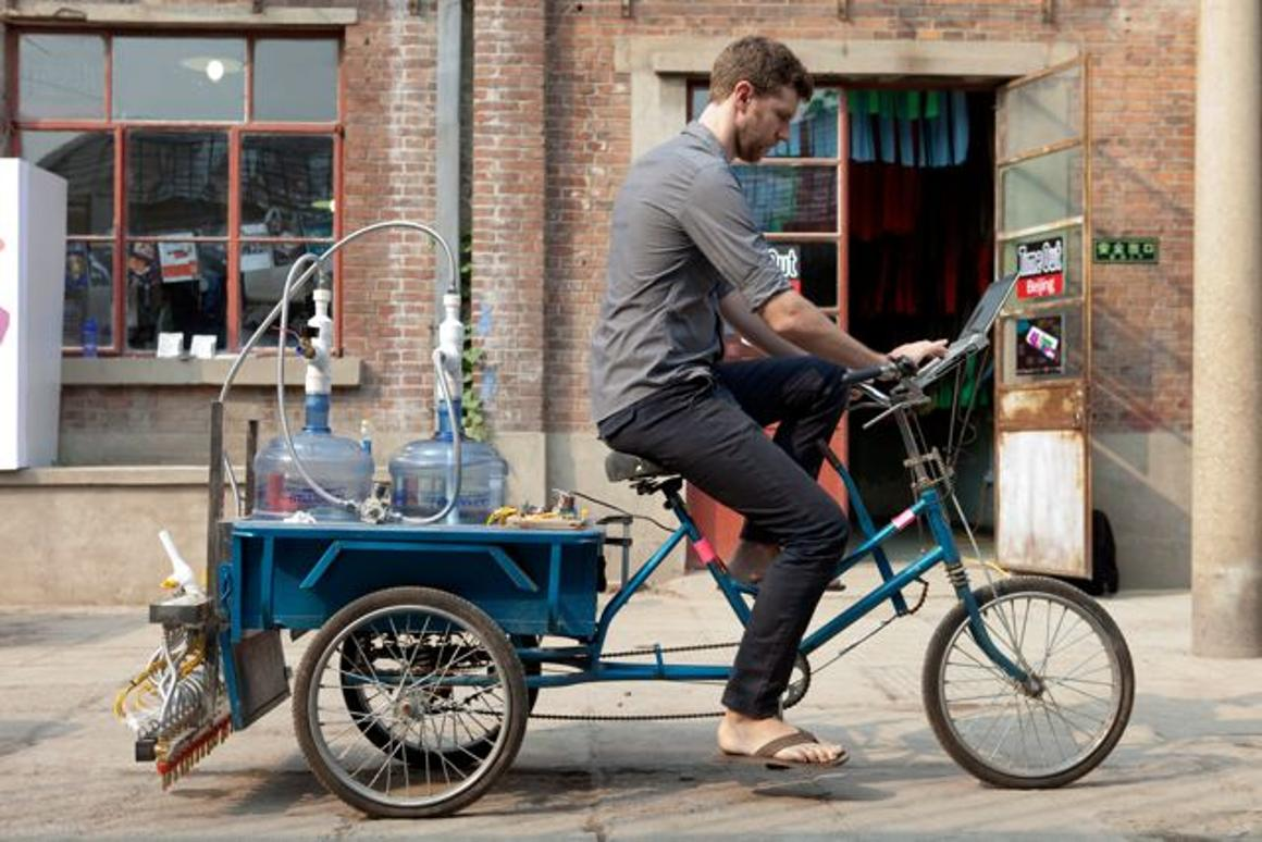 Artist Nicholas Hanna has created a cargo tricycle-based system that prints Chinese calligraphy on the road, in water