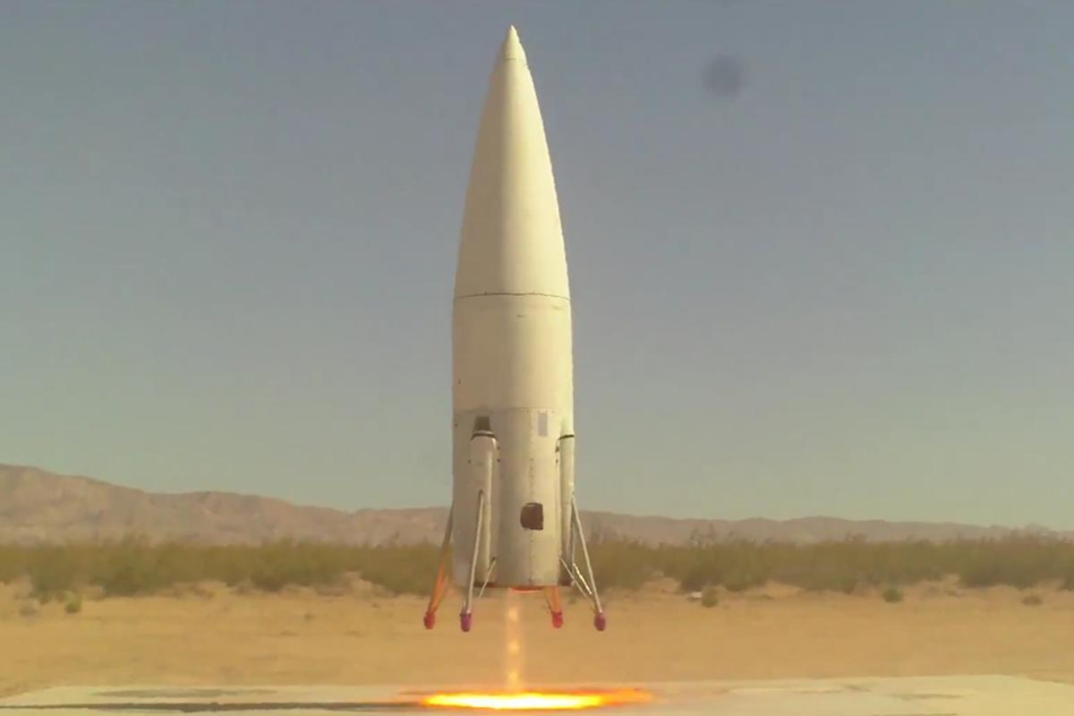 The Masten Xaero landing vertically on it's launch platform in the Mohave desert