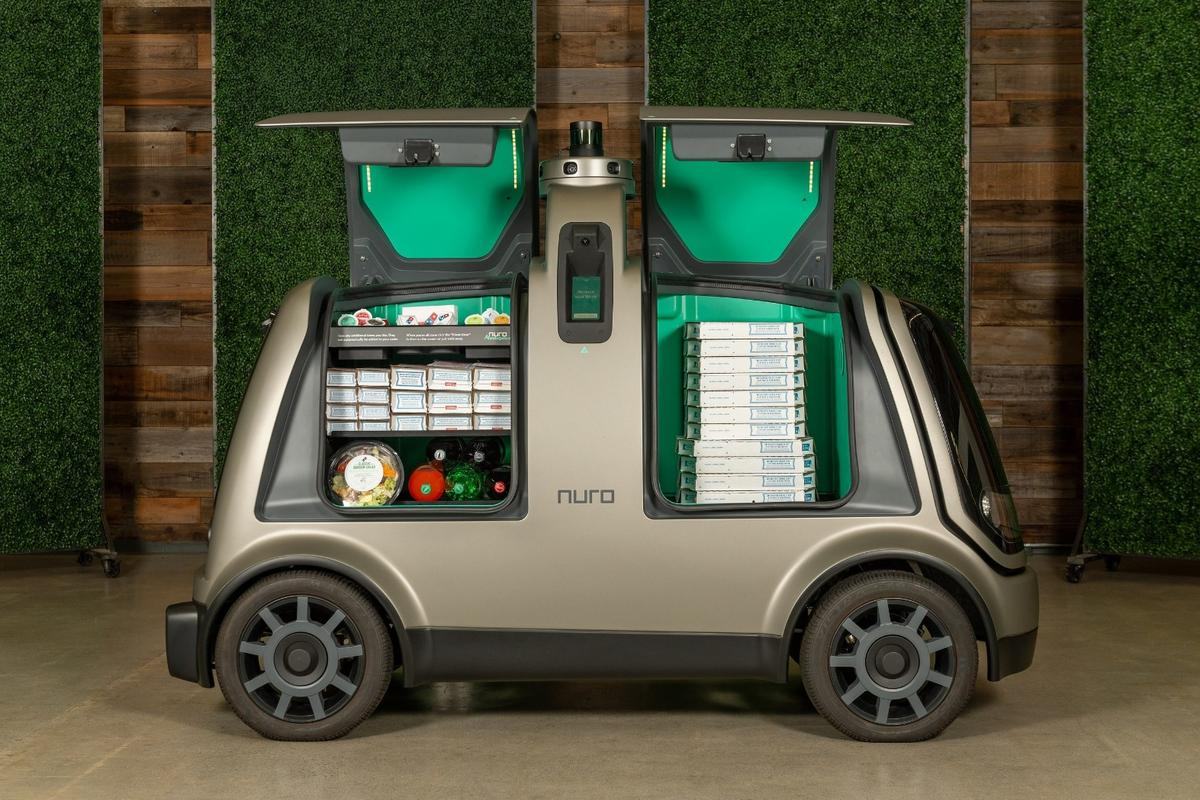 Nuro's self-driving pod called R2 is built to roam the streets with its cargo holds loaded up with food items for hungry customers