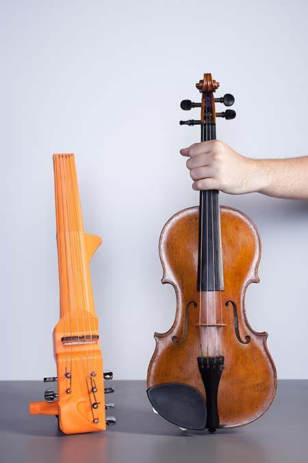 The 3D-printed frame of Sean Riley's custom 6-string violin sizes up against a classic 4-string model