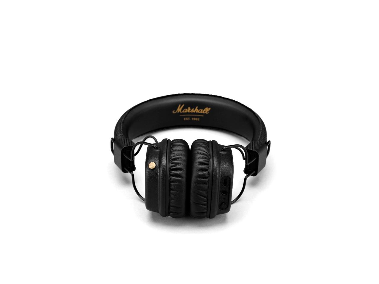 The left earcup is home to a brass-colored analog control knob which allows listeners to play, pause and shuffle tracks, and adjust volume