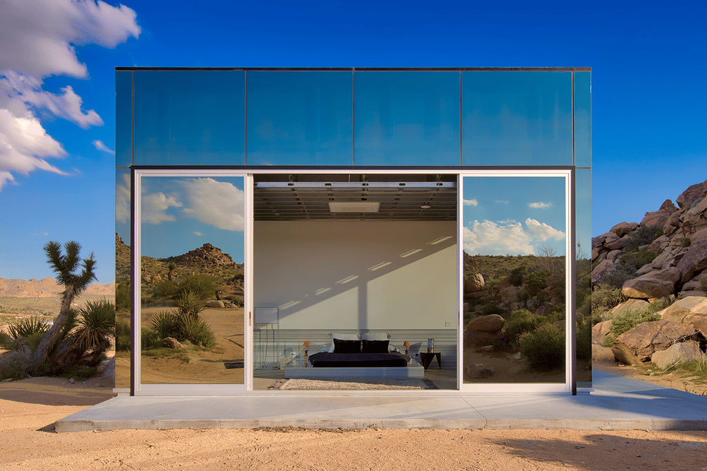 The Invisible House's bedrooms open up to the outside with sliding walls