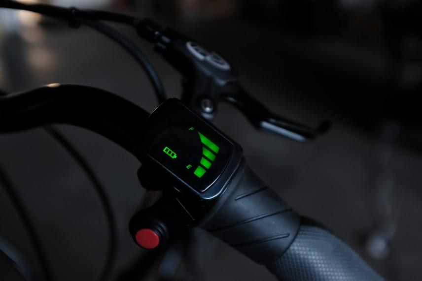 The Cruzbike T50e's handlebar unit, including its throttle switch