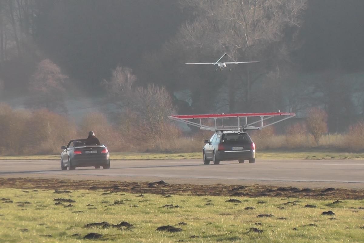 The drone coming in for an autonomous landing on a moving vehicle
